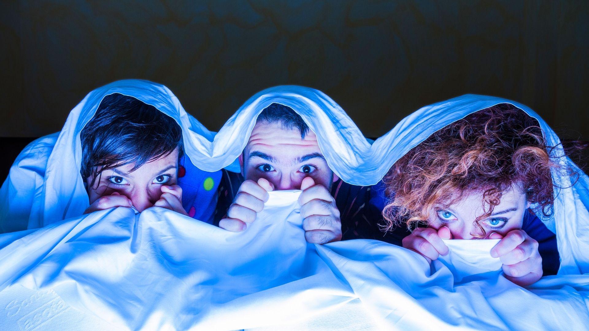 Halloween hiding under sheets