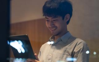 Man reading a tablet