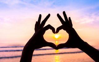 Heart drawn in fingers